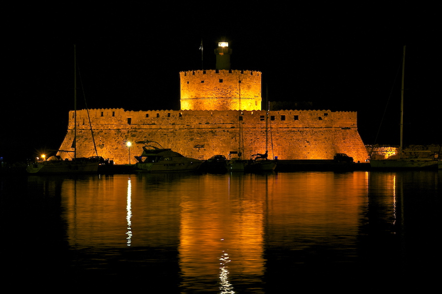Saint Nicolas Fort Rhodes Harbour at night, medieval Greece yacht charter