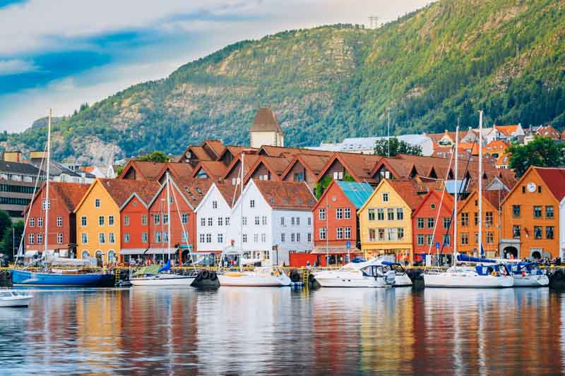 Colourful Norwegian architecture on Norway yacht charter