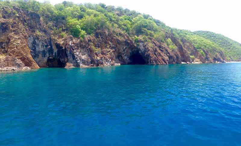 Coast of Peter Island on a yacht charter itinerary in British Virgin Islands