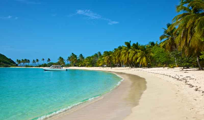 Beach in Mayreau on a yacht charter itinerary Grenada