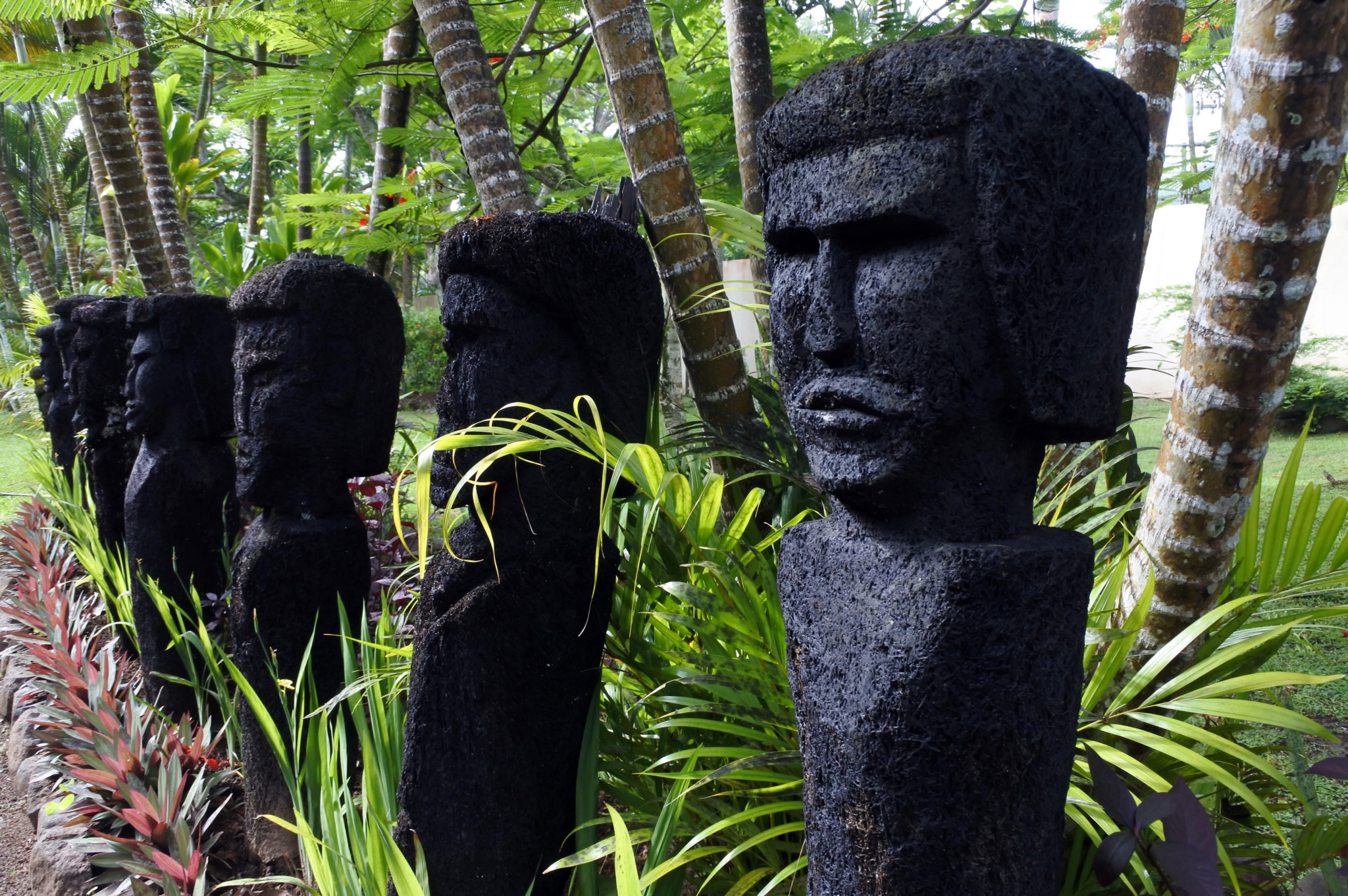 Row of totems on a Fiji yacht charter