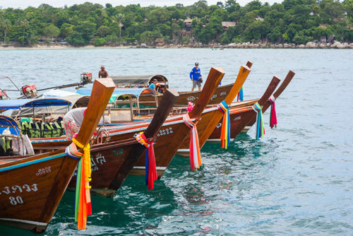 Wooden colourful river boats on Thailand yacht charter