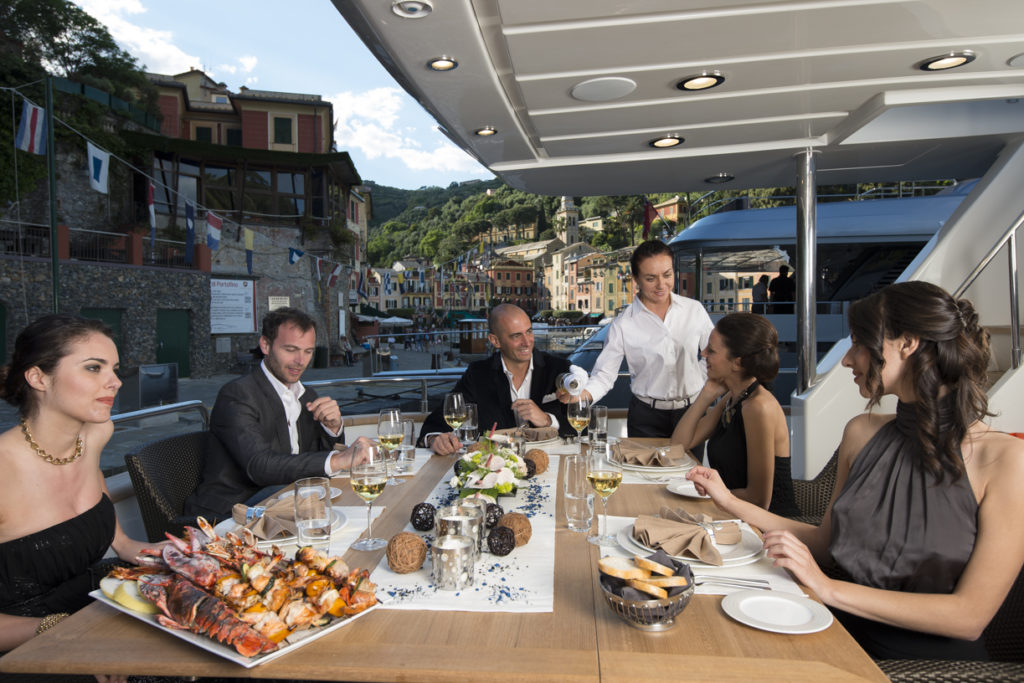 Dining on deck on a yacht charter itinerary Monaco