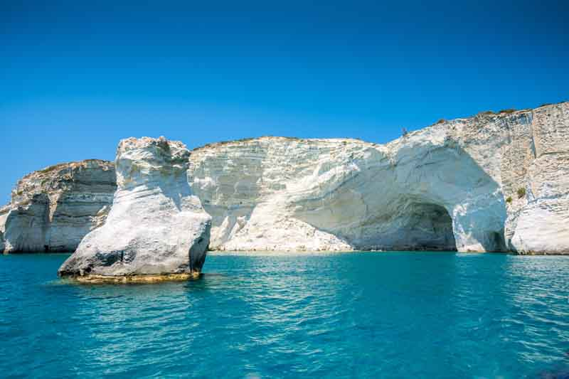 Rugged cliffs of Milos on a yacht charter itinerary Cyclades