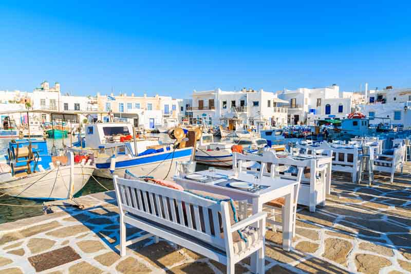 Dining in Paros harbor on a yacht charter itinerary Cyclades