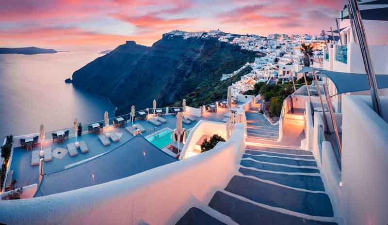 Sunset in Santorini on a Cyclades yacht charter itinerary