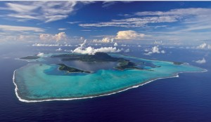 Aerial view of an island on a yacht charter itinerary South Pacific