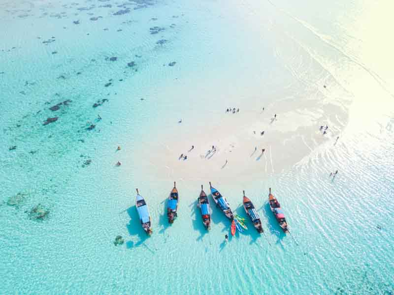 Traditional sea boats on a Thailand yacht charter itinerary