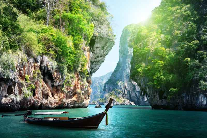 Passage between cliffs on a yacht charter itinerary Thailand
