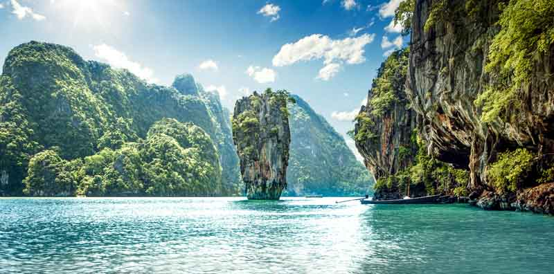Limestone cliffs in Khao Phing Kan on a yacht charter itinerary Thailand